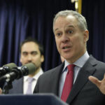 New York Attorney General Eric Schneiderman speaks at a new conference in New York, Monday, March 21, 2016. The nation's two largest daily fantasy sports websites have agreed to stop taking paid bets in New York through the end of baseball season, in September, as lawmakers consider legalizing the popular online contests, the state's attorney general announced Monday. (AP Photo/Seth Wenig)